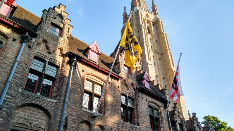 Flags flying in front of the Church of Our Lady